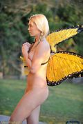 blonde alison angel in her butterfly wings
