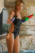 sexy kelly brooke with her water gun