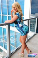 stacy shey blond hair and short blue dress